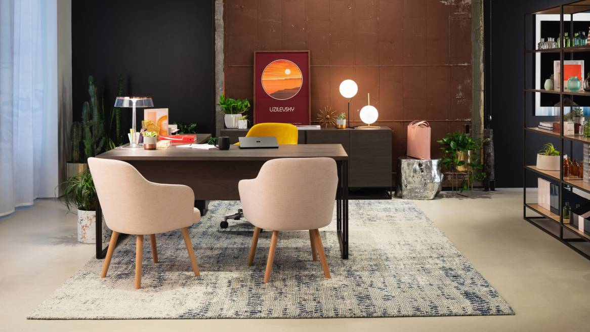 Products from the Steelcase and West Elm partnership are shown in an office setting, including a Greenpoint filing credenza, Greenpoint private desk, and Sterling Guest and Conference seating