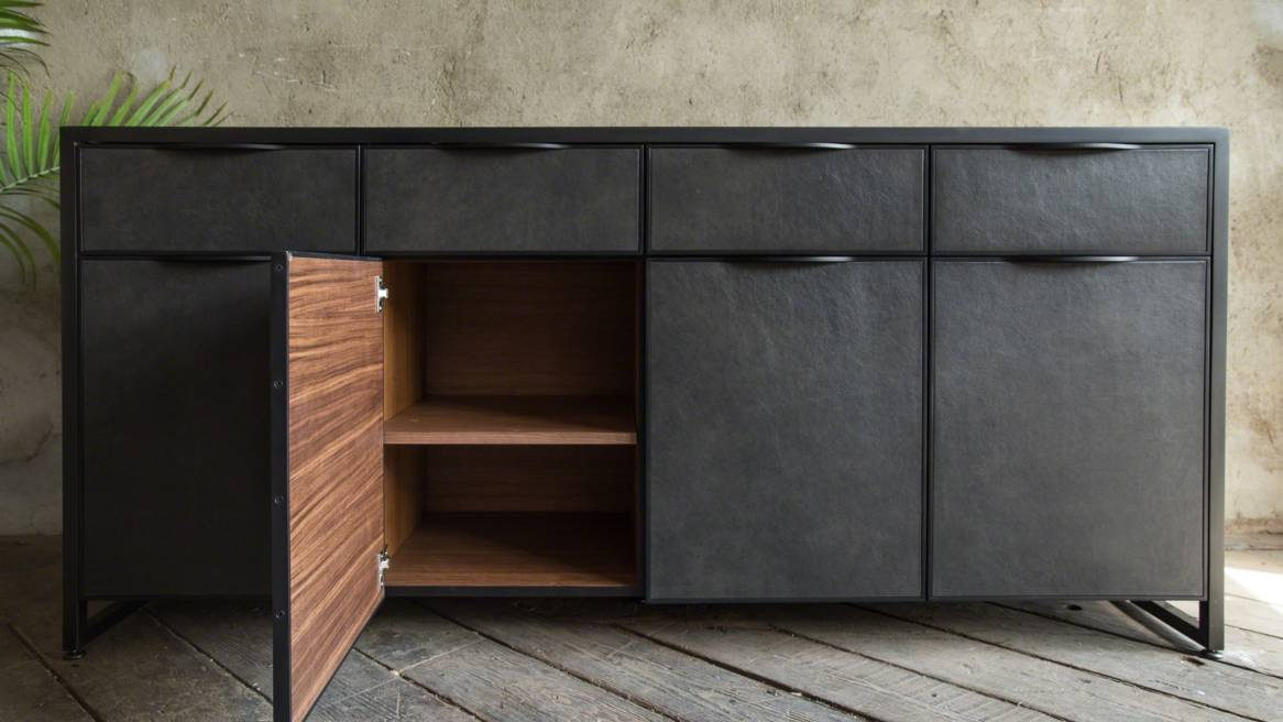 Uhuru Cairns Credenza placed in front of a wall