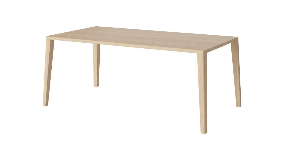 On-white image of the Graceful Dining Table in a rectangular shape and light finish.