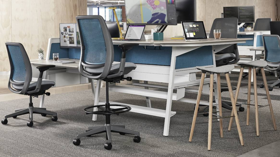 Height adjustable desk and Amia stool