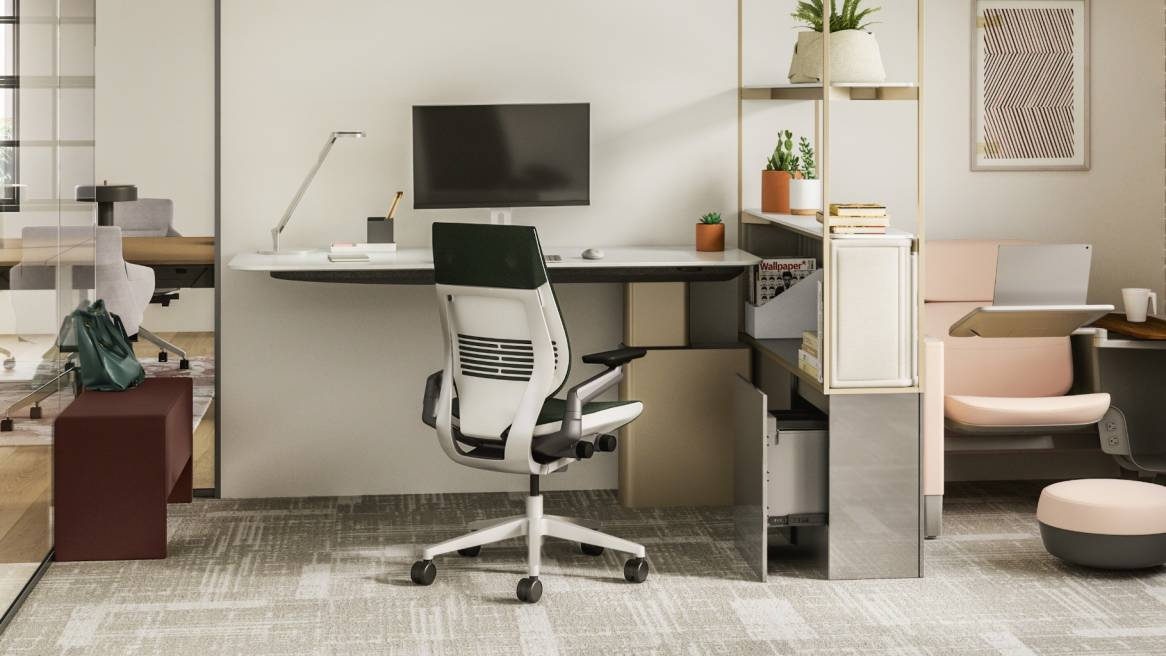 Work space with a desk and monitor, a white and black Gesture chair