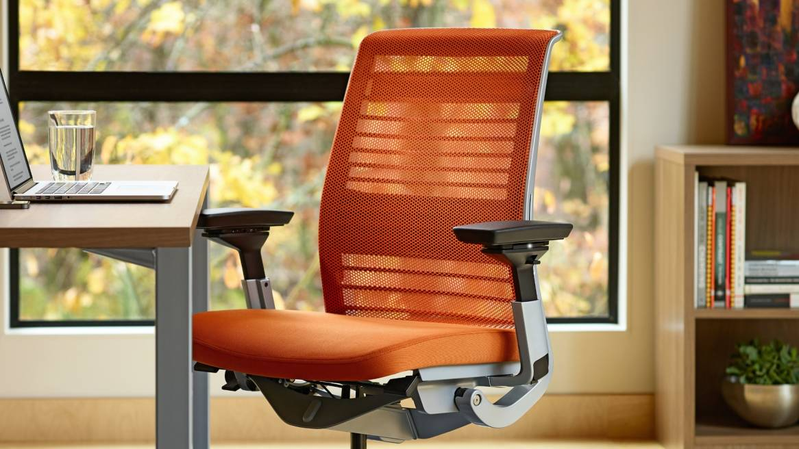 Close up to an orange Think chair