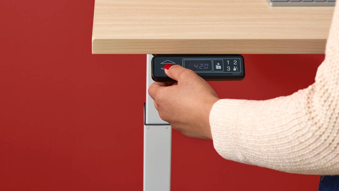 Close up of Bivi Height Adjustable Desk powered lever
