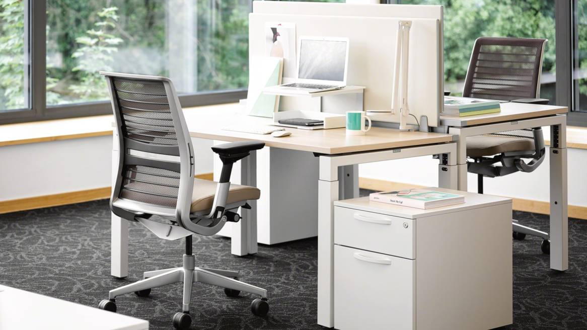 Implicit personal storage next to a FrameFour workstation and Think office chair