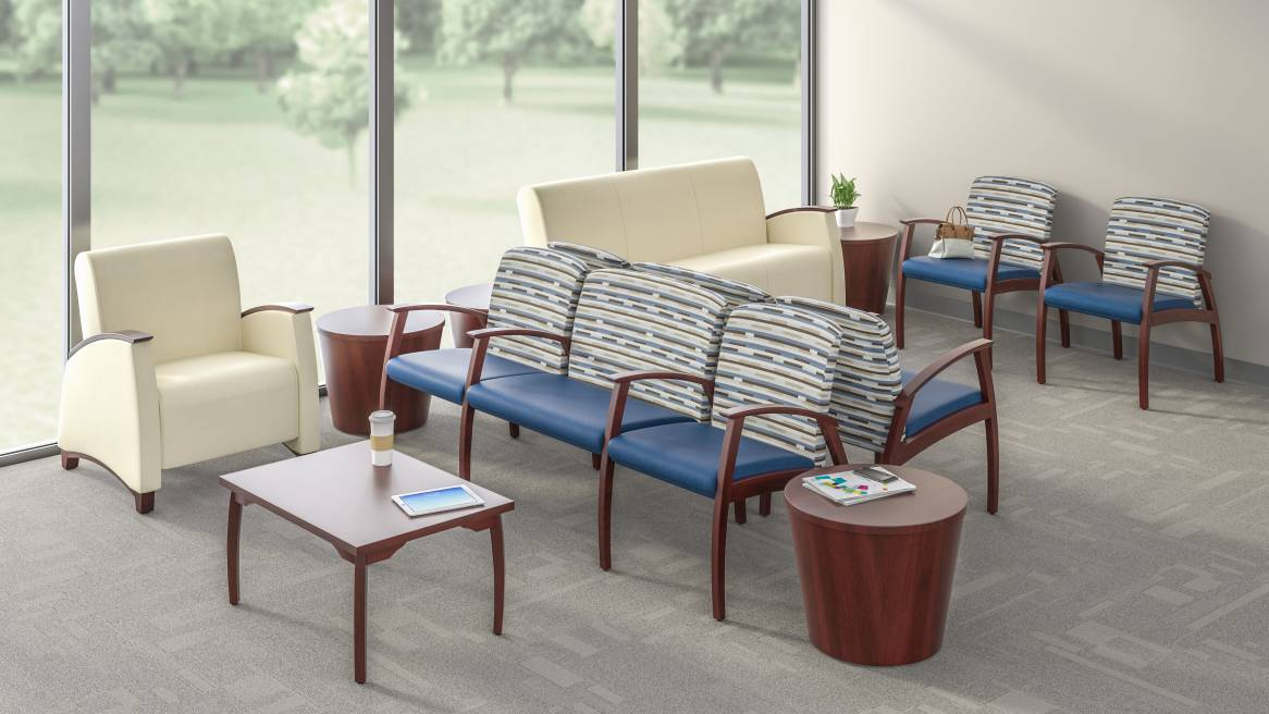 Health waiting space equipped with beige Mitra Guest Single-Seat, Lounge, Sofa, a Bariatric Combination Unit and wooden Tables