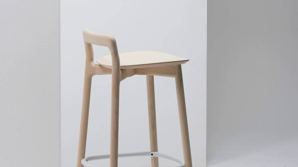 side view of branca bar stool in a natural ash color