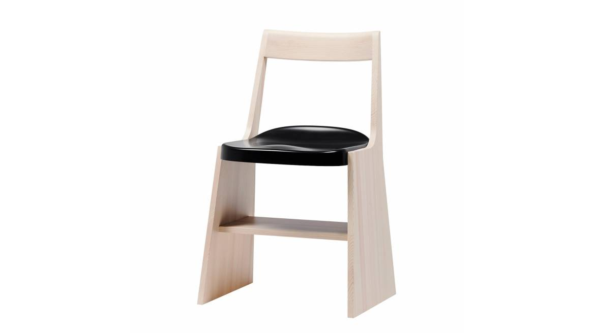 A light wood Fronda Chair with black seat on white background.