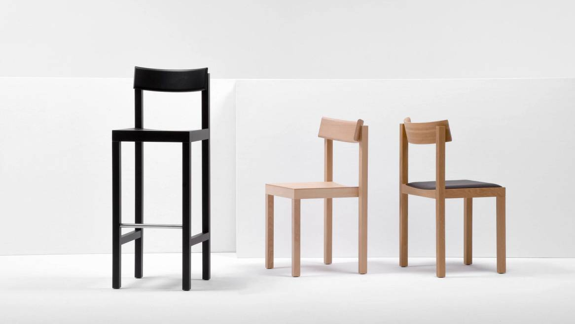 Mattiazzi Primo Chairs in Natural Ash and Natural Oak with a brown upholstery seat, and a black Primo Stool