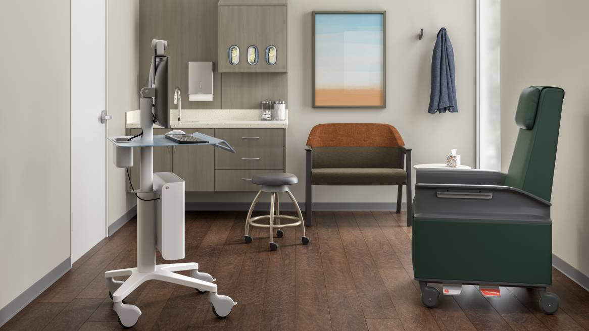 inside a medical exam room with a green Empath chair