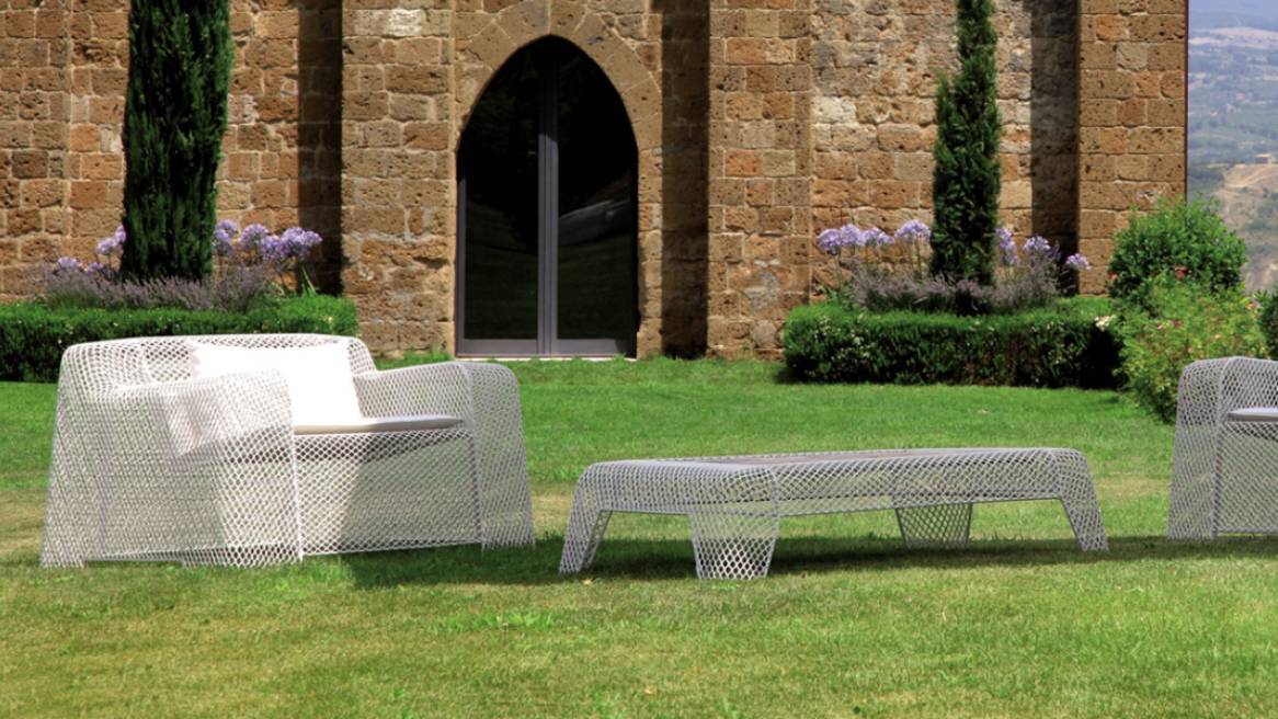 Emy Ivy outdoor lounge chairs and table outside on grass