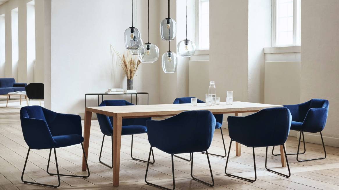 Kimono dining chairs in blue around a square table