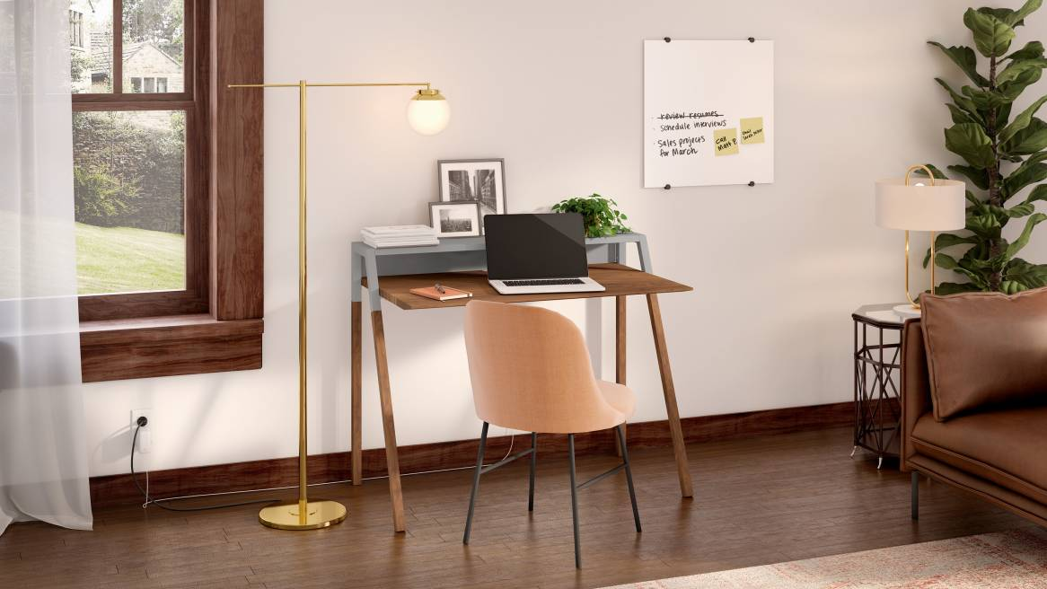 Home office space equipped with PolyVision Nota, a wooden desk and a light brown chair.