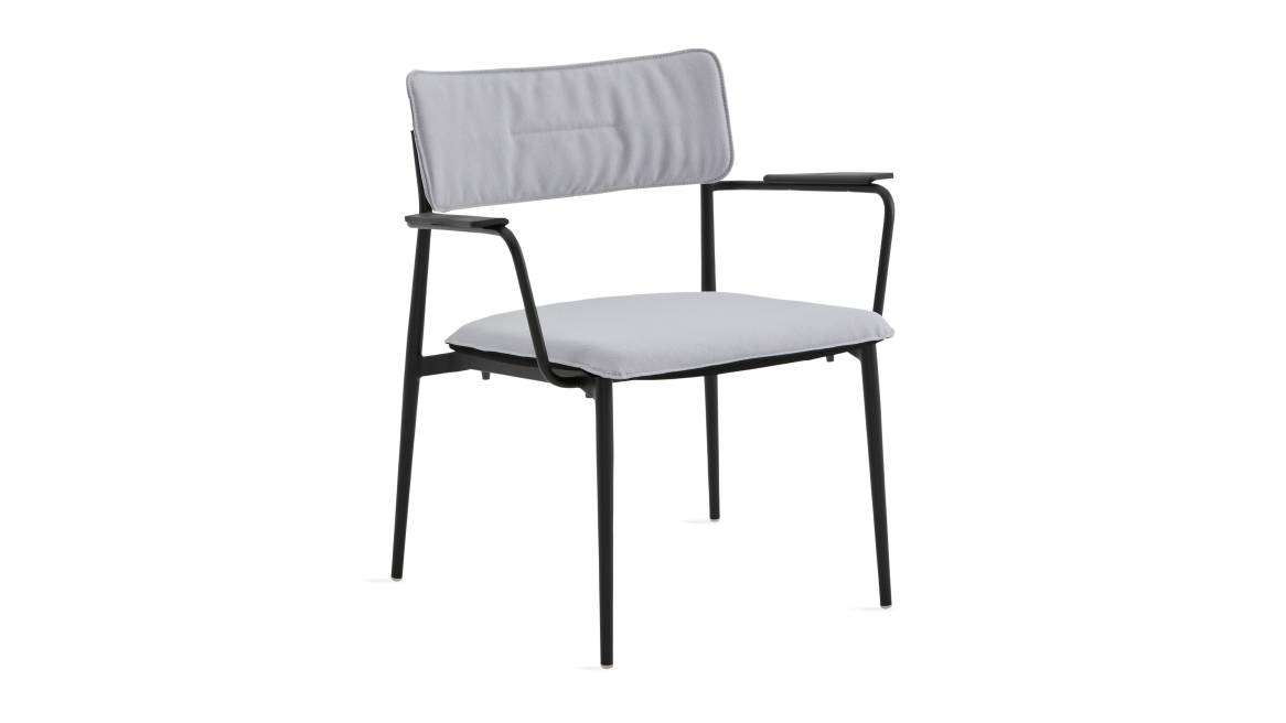 simple lounge chair with white cushion and black base