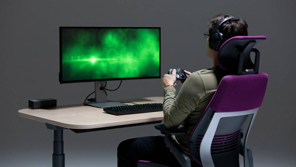 man sitting in a Gesture chair while playing videogames