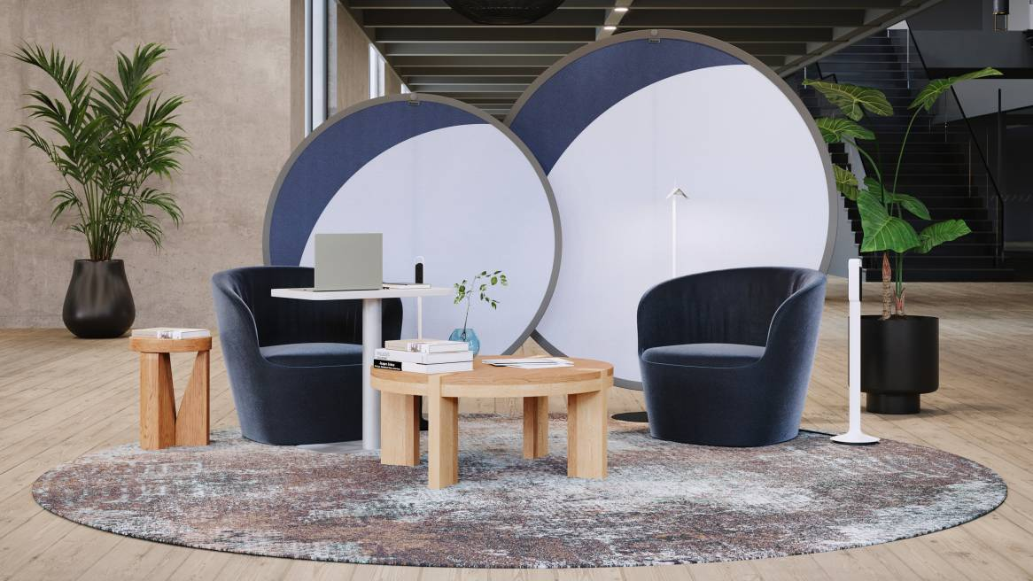 Nomadic Lounge Space equipped with navy blue West Elm Work Willow Lounge Chairs, white and blue Steelcase Boundary Tents and West Elm Boerum Coffee Table in Natural Oak.