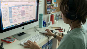 Child sitting at a desk on a computer