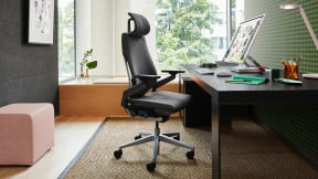 Inside a private office with a black Gesture chair with head rest