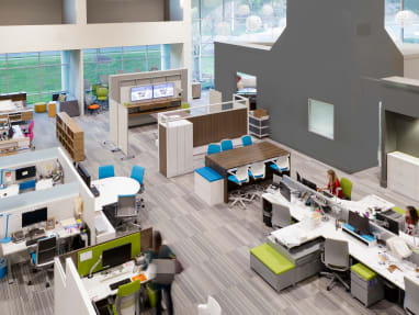 Overhead view of an office setting with Steelcase products, including Cobi chairs, Campfire Big Table, Bivi Depot shelving, Think chairs, and Gesture chairs