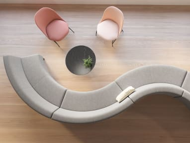 Overhead view of a gray Circa lounge system configuration with two pink chairs and a black table nearby