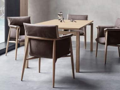 Embrace chairs CHE005 by Carl Hansen & Son arranged around a table