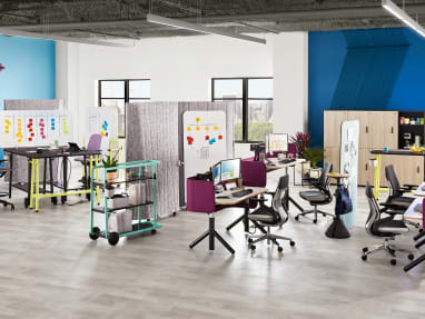 An office environment that includes Steelcase Flex height-adjustable desks, Gesture desk chairs, Flex Slim tables, SILQ stool height chairs and Steelcase Flex carts