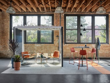 Enea Lottus bar-height stools are shown next to a Montara650 table beside an Orangebox Air23 pod with West Elm Slope Lounge Chairs and a Bolia Mix coffee table