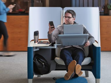 Man sitting on a Brody Lounge Seating by Steelcase.