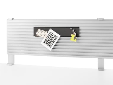 On-white image of a tackstrip being used with a slatwall.
