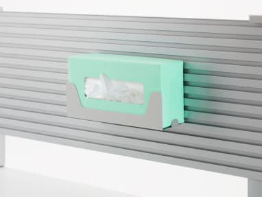 A tissue box rests in the tissue box holder affixed to the slatwall