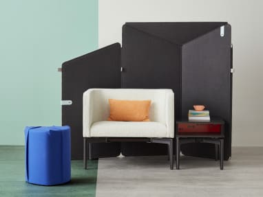 Ancillary space equipped with electric blue Turnstone Campfire Pouf, gray Bivi Rumble Seat and black Bassline Box Top Table surrounded by drak gray Clipper Screen