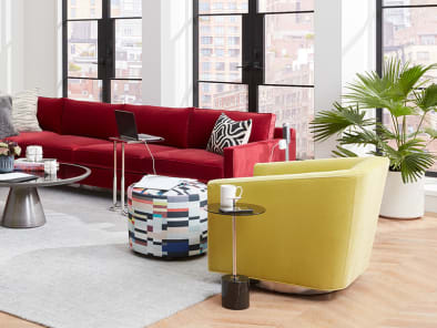 Mitchell Gold + Bob Williams sofas, chairs, and tables in an office lounge setting