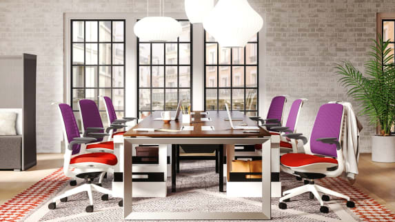 Purple and red Steelcase Series 1 Office Chairs in a conference setting at a large table