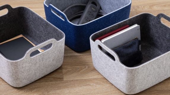 A Steelcase Flex Power Hanger and other items are shown in accessory baskets from the Steelcase Flex collection