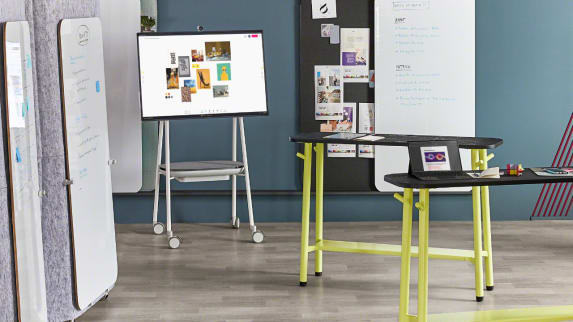 A Steelcase Roam Mobile Cart in a meeting room with Steelcase Flex standing height tables and Markerboards