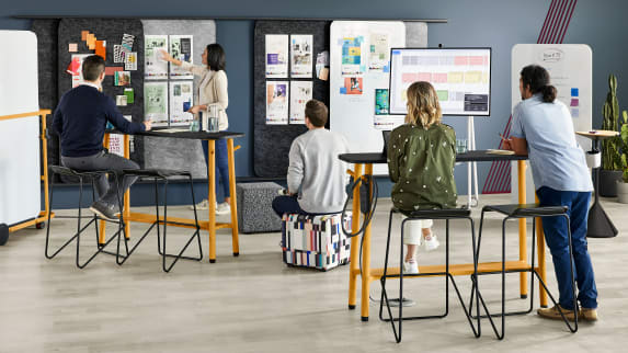 Team collaborating in environment with Steelcase Flex Collection furniture