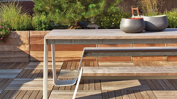 An outdoor rooftop space with an Extremis Hopper table