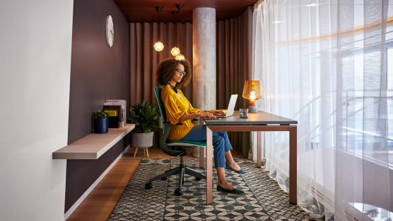 woman sitting on a SILQ in front of a desk
