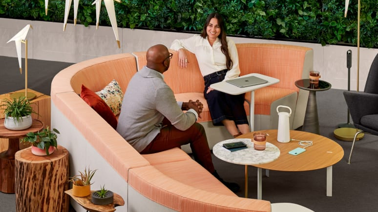 Two people having a conversation in a collaborative setting outfitted with partner products.