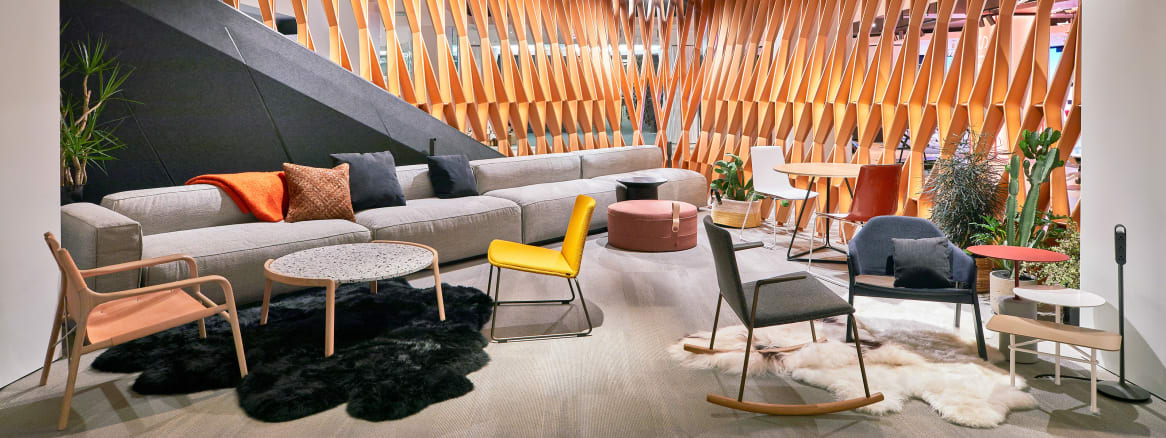 A selection of Steelcase products are showcased in a lounge-style setting during NeoCon 2018, including a Carl Hansen PK1 chair, a Montara650 rocker, Montara650 lounge chair, and Bob occasional table