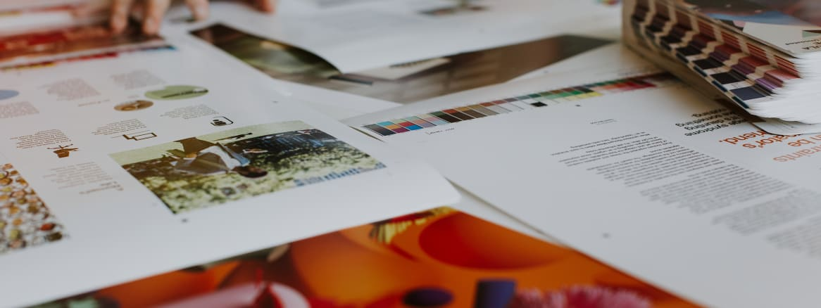 magazine sheets on a table being arrange