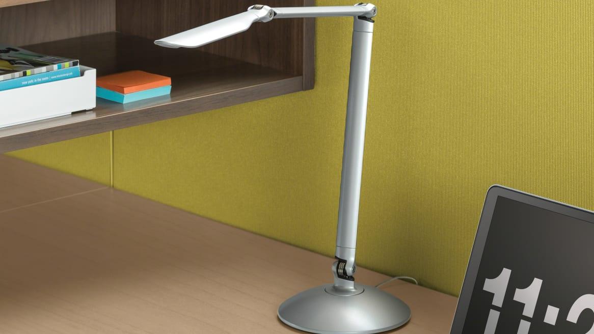 Silver LED Linear Desktop Task Light on desk next to a wooden storage