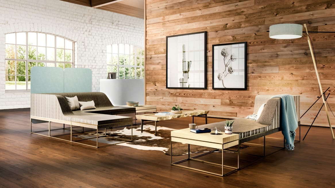 two umami lounges with wooden table on a side, blue blanket on the sofa