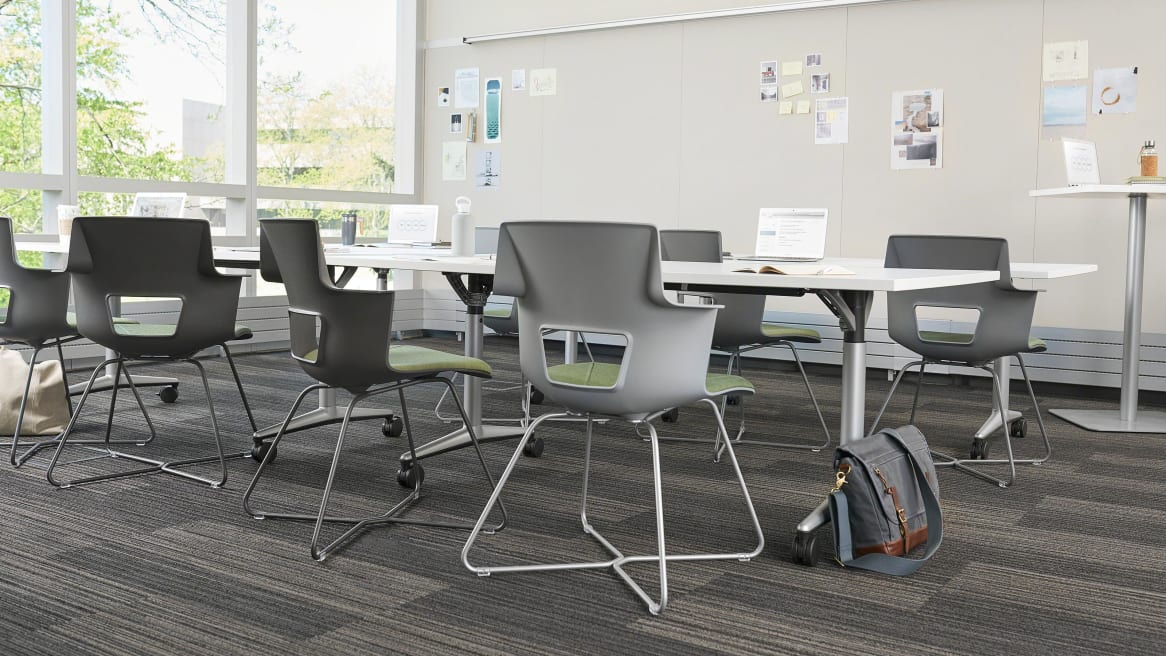 Shortcut X Base chairs around desk tables in classroom
