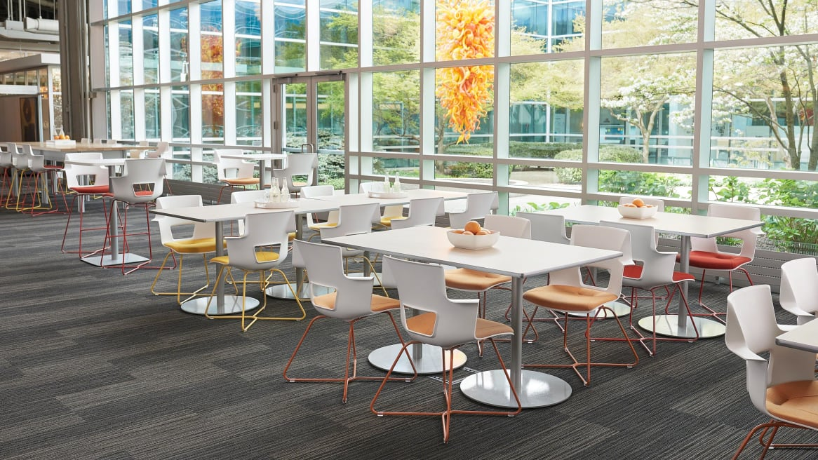 Shortcut X Base chairs around tables in eating area