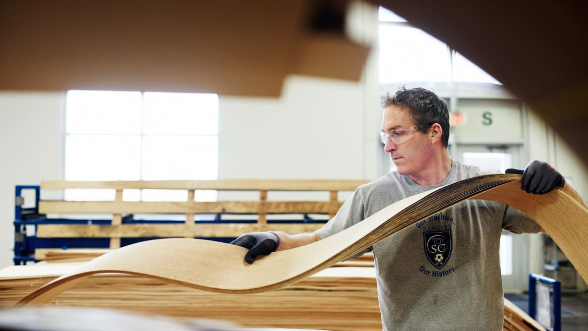 A man working with wood