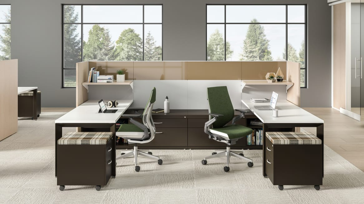 A workstation consisting of Answer panels, VIA walls, Gesture chairs from Steelcase with green upholstery, and TS series storage with plaid upholstery