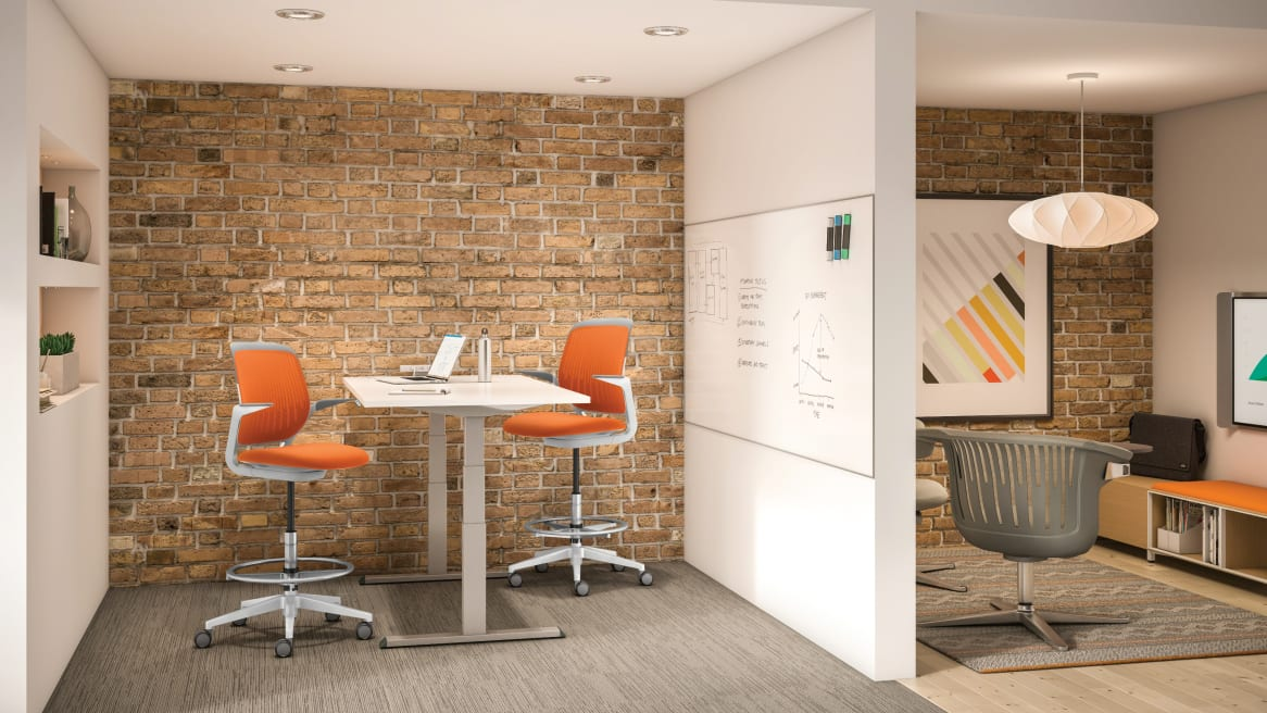 Migration height-adjustable desk and cobi chairs