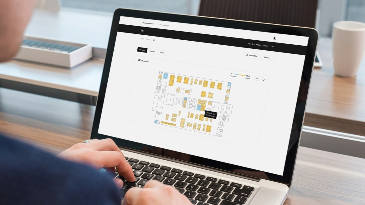 Picture of a man looking at a Floorplan on his laptop's screen.