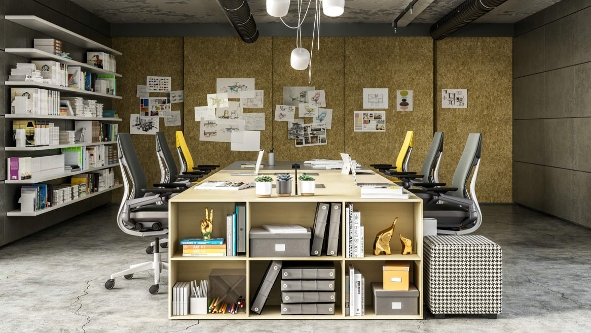 A Steelcase FrameOne benching system is used to create a workstation that also features Gesture chairs and Bivi Depot shelving