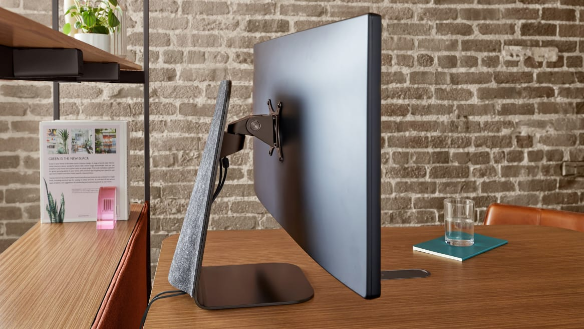 Forco elegant computer monitor mount in black with charcoal upholstery on a wood desk